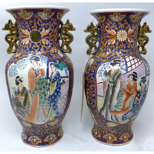 194 - A pair of early 20th century Chinese vases, with twin gilt dragon handles, hand painted with vignett...