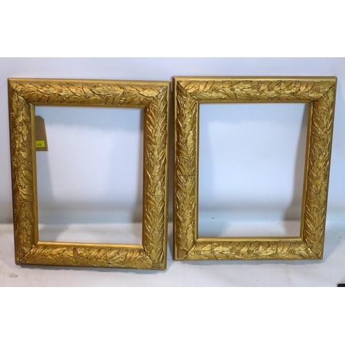 219 - A pair of 20th century gilt wood picture frames with leaf border, 62 x 50cm...