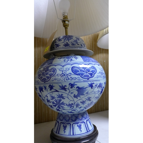 48 - A pair of Chinese blue and white porcelain jars and covers, converted to lamps, H.46cm...