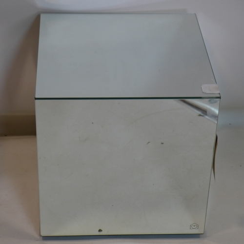 147 - A mirrored glass cube side table, with makers label, H.42 W.40 D.40cm...