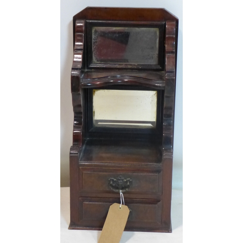 373 - A Victorian mirrored back mahogany wall cabinet with two drawers, H.61 W.28 D.23cm...