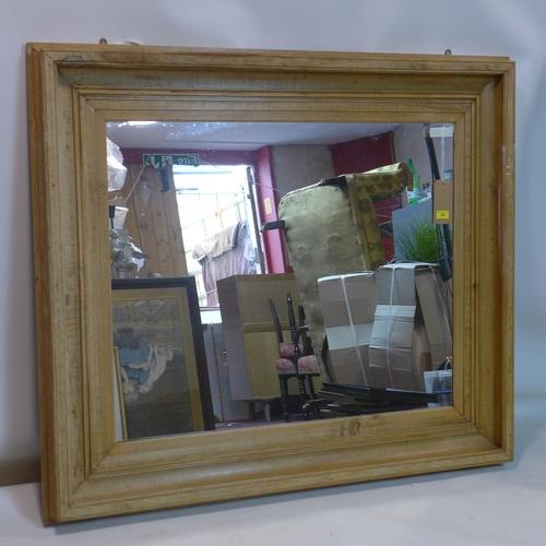 391 - A 20th century large pine mirror, 135 x 115cm...