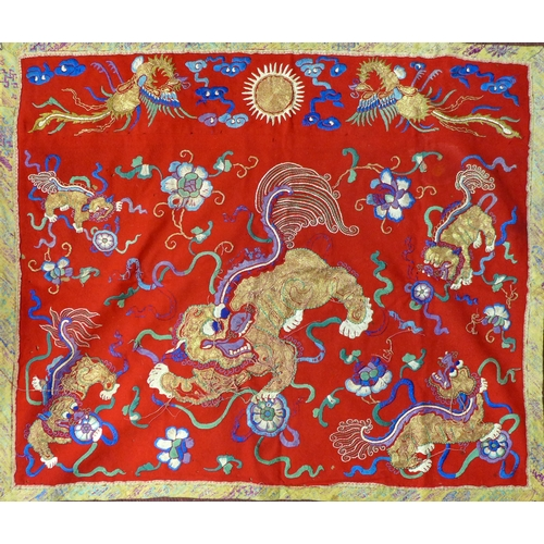 406 - A late 19th century Chinese embroidery depicting Dogs of Fo and phoenixes, 73 x 84cm...