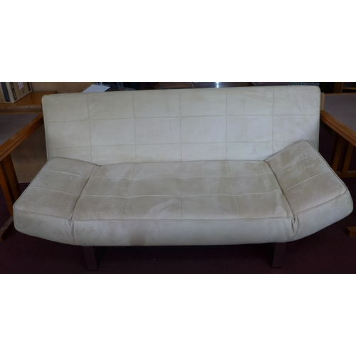 414 - A Bo concept beige suede sofa bed raised on chrome supports...