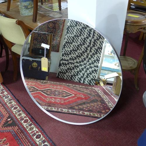 173 - A contemporary silver framed circular mirror, D.90cm...