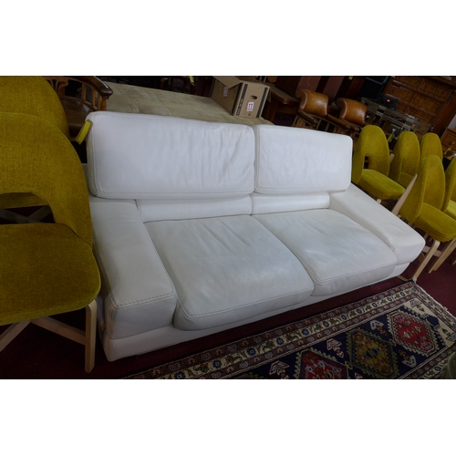 229 - A Roche Bobois white leather sofa with reclining back rests...