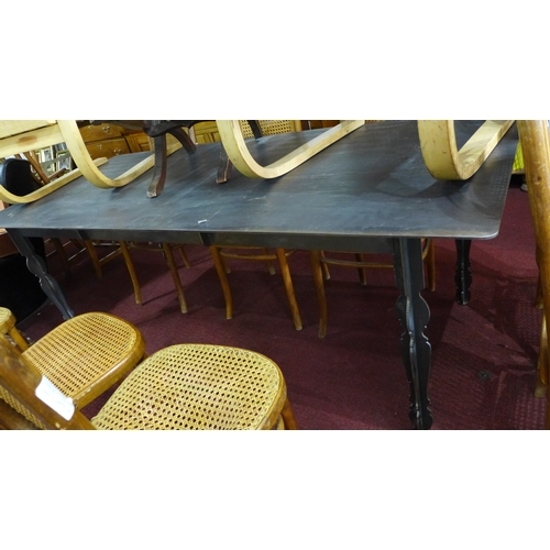 428 - A cast iron dining table with wood effect top by South African furniture maker DeSteyl. H.77 W.210 D...
