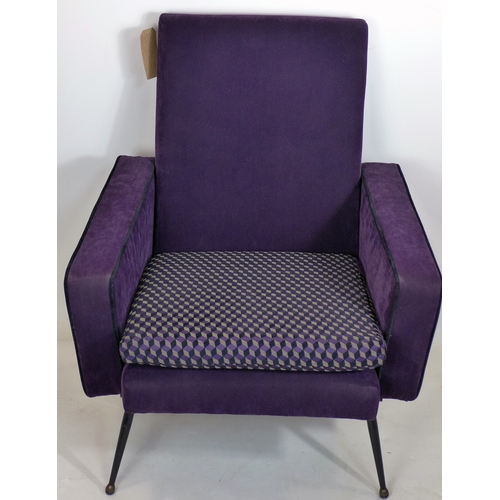 209 - A mid 20th century purple velour easy chair, raised on tapered legs...