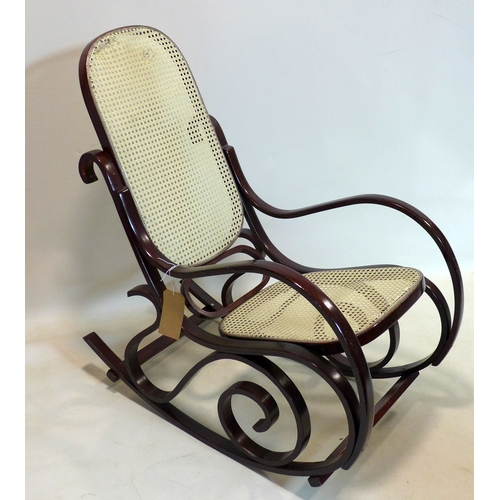 257 - A bentwood and cane rocking chair...
