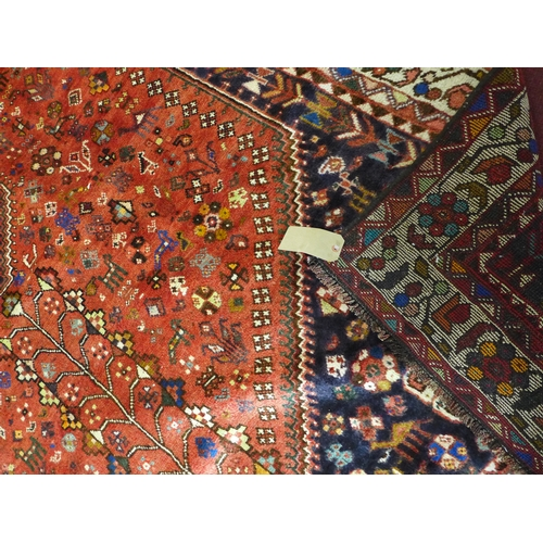 67 - A South West Persian Qashqai carpet, central diamond medallion with repeating petal and animal motif...