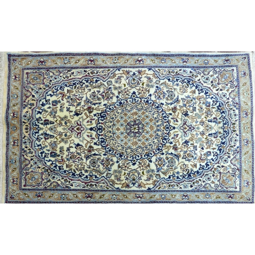 69 - A Central Persian part silk Nain rug, central floral medallion with repeating petal motifs on an ivo...