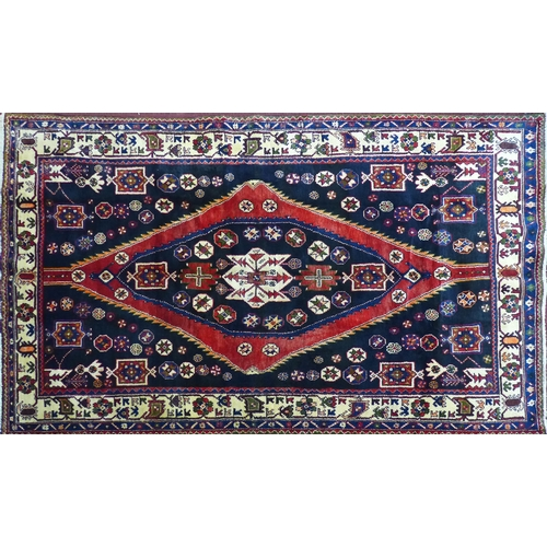 71 - A North West Persian Zanjan rug, central diamond medallion with repeating petal motifs on a black fi...