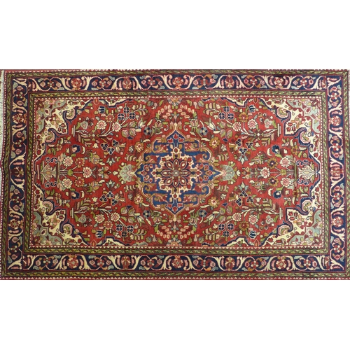 73 - A North West Persian Borchelu rug, double pendent medallion with repeating spandrels and petal motif...
