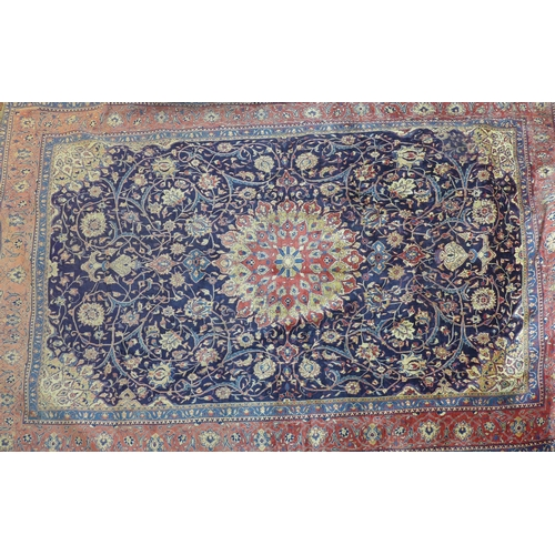89 - A North West Persian Sarouk carpet, double pendent medallion with repeating petal motifs on a sapphi...