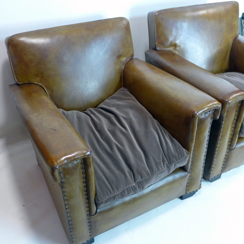 201 - A pair of 20th century studded brown leather armchairs...