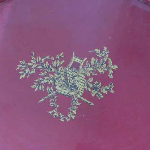 266 - A 20th century Italian red toleware tray, with gilt floral decoration, raised on folding stand, H.46...