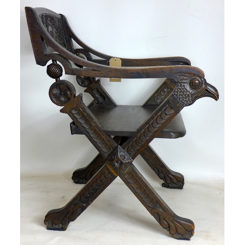 328 - A 19th century Continental carved oak armchair...