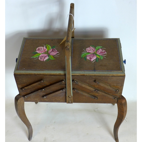 334 - A 20th century oak sewing box raised on cabriole legs...