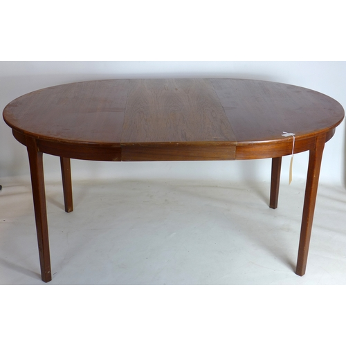 336 - A 20th century Danish teak dining table with extra leaf, H.73 W.158 D.113cm...