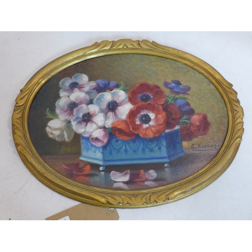 50 - G. Corbier (French) An early 20th century oval, oil on board of a still-life of anemones in a blue c...
