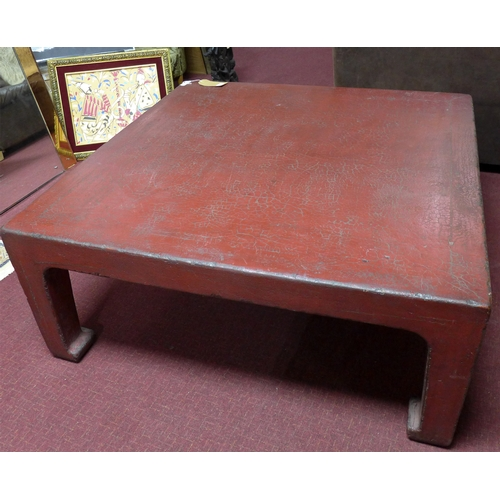 321 - A large Chinese crackle glazed red lacquered coffee table, with wax seal mark to base, H.50 W.120 D....