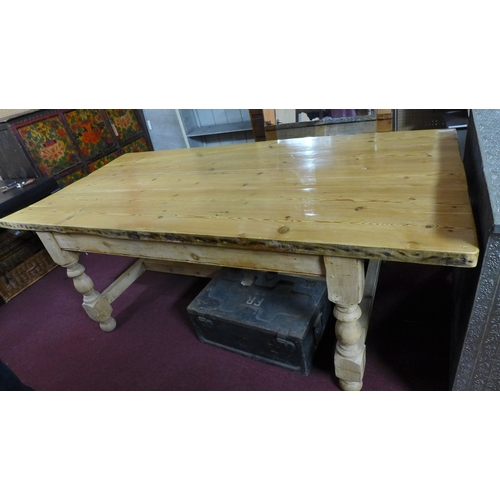 350 - A 20th century pine dining table, H.77 W.215 D.103cm...