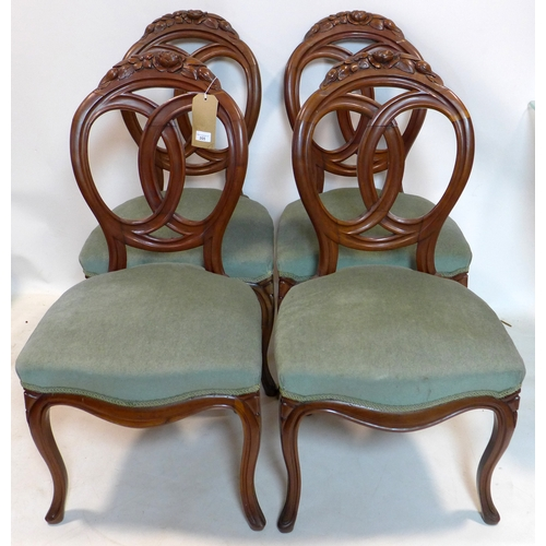 355 - A set of four early 20th century mahogany dining chairs with velour upholstery...