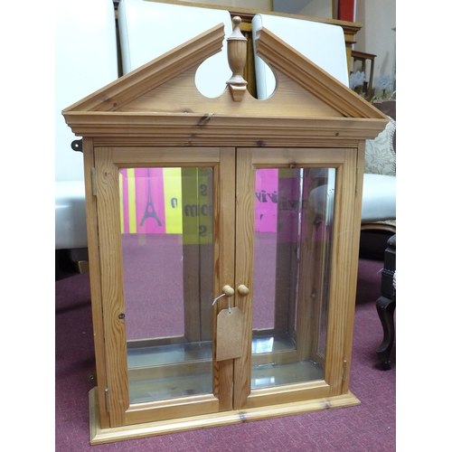 374 - A pine wall hanging cabinet with mirrored back and bevelled glass panels, H.86 W.67 D.23cm...