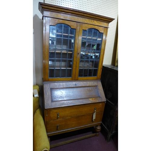 311 - An early 20th century oak bureau bookcase, H.192 W.92 D.45cm...