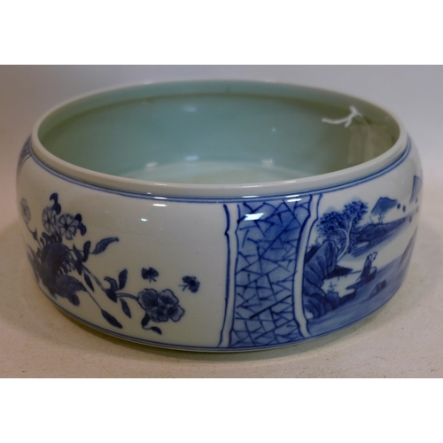 40 - A Chinese, hand-painted blue and white porcelain brush washer decorated to the outside with 2 landsc...