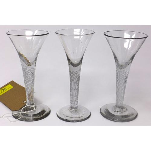 16 - Three Georgian wine glasses with twist stems, on circular bases, H.17cm...