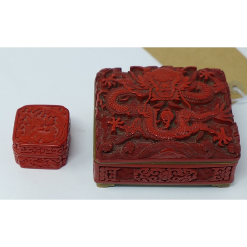 38 - A late 19th/early 20th century Chinese cinnabar lacquer box, relief decorated with a dragon and vign...