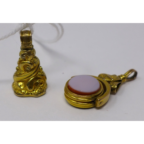 53 - Two 19th century yellow gold fob pendants, one with circular agate and bloostone panels 3 x 2cm, the...