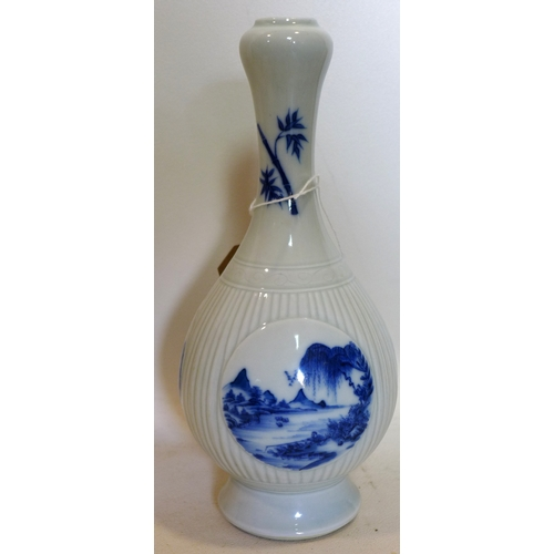 48 - A Chinese blue and white porcelain vase with six character marks to base, H.25cm...