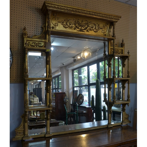 51 - A large early 19th century giltwood mirror, having bevelled glass plates, the central plate flanked ...