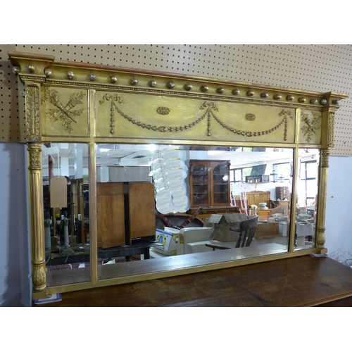 57 - A Regency gilt overmantle panelled mirror, three bevelled glass plates, decorated with torcheres, fl...