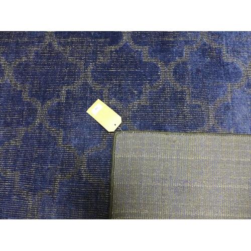 74 - A contemporary woollen midnight blue carpet, 241 x 170cm...