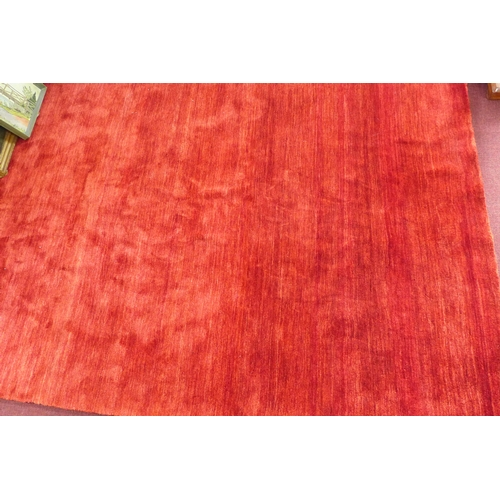 114 - An Indian woolen Gabbeh carpet, red ground, with 100,000 knots, 335 x 245cm...