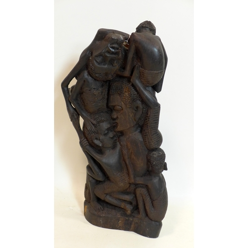 202 - A 20th century Makonde hardwood carving, H.57cm...