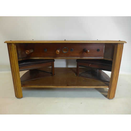129 - An oak coffee table with glass top converted into a football table with 2 small stools, H: 53, L: 10...