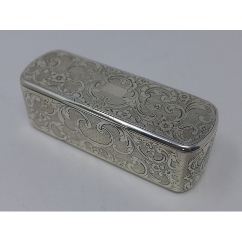 6 - A Continental silver snuff box, with engraved C-scroll decoration on an engine turned ground and vac...