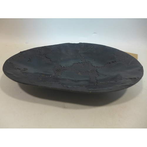 81 - A 19th century, large hand-carved jet dish adorned with vine leaves in relief, 3.5 x 29.5cm...