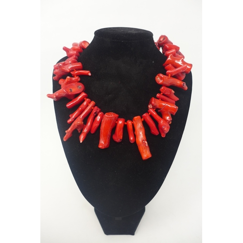 205 - A sterling silver clasped large red coral bead necklace composed of 38 natural coral chunks, L: 48cm...