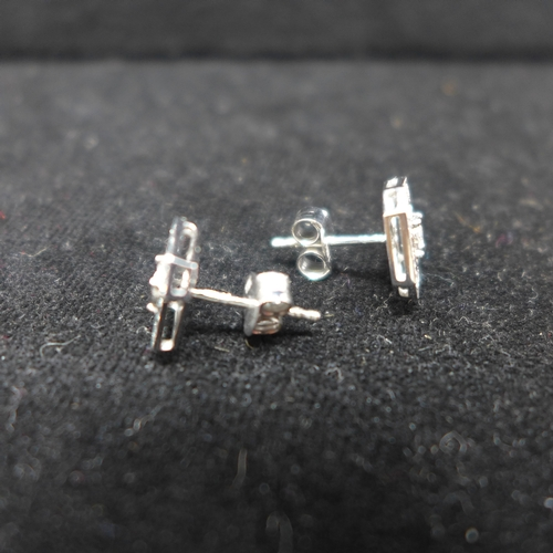 255 - A boxed pair of 18ct white gold and brilliant cut diamond stud earrings (0.40 carats in total approx...