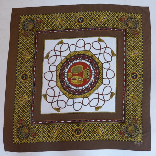 8 - A Hermes, Paris, silk scarf, decorated with crowns and mitres...
