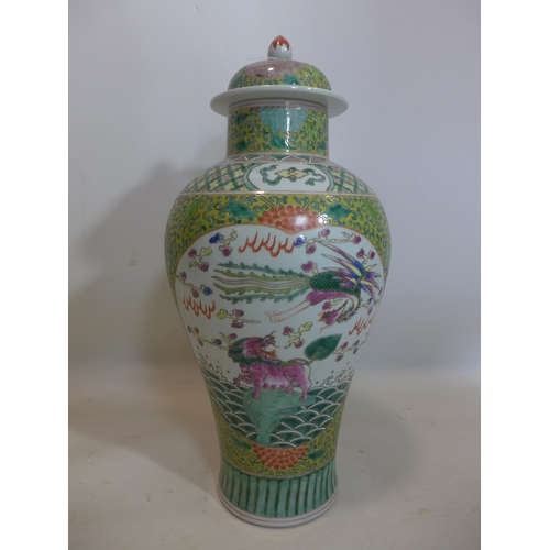 174 - A Chinese Republic period famille rose lidded temple jar, hand-enamelled with dragons and carp, six ...
