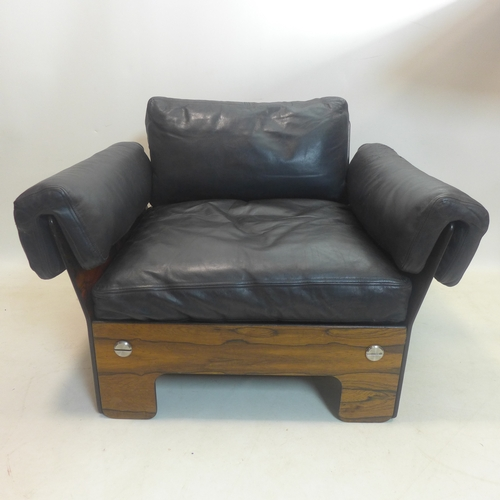 203 - A 1970's Danish style exotic hardwood armchair, with black leather upholstery and chromium bolts, H....