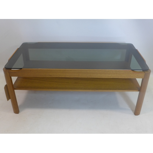 309 - A mid 20th century teak coffee table, with smoked glass top, H.39 W.85 D.44cm...