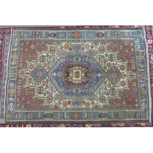 75 - A North West Persian Nahawand rug, central diamond medallion with repeating petal motifs on an ivory...