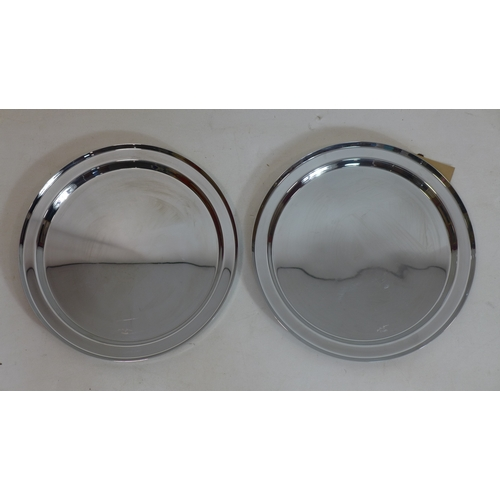 365 - Two large Christofle circular serving trays in stainless steel, both signed, dia: 39cm each...